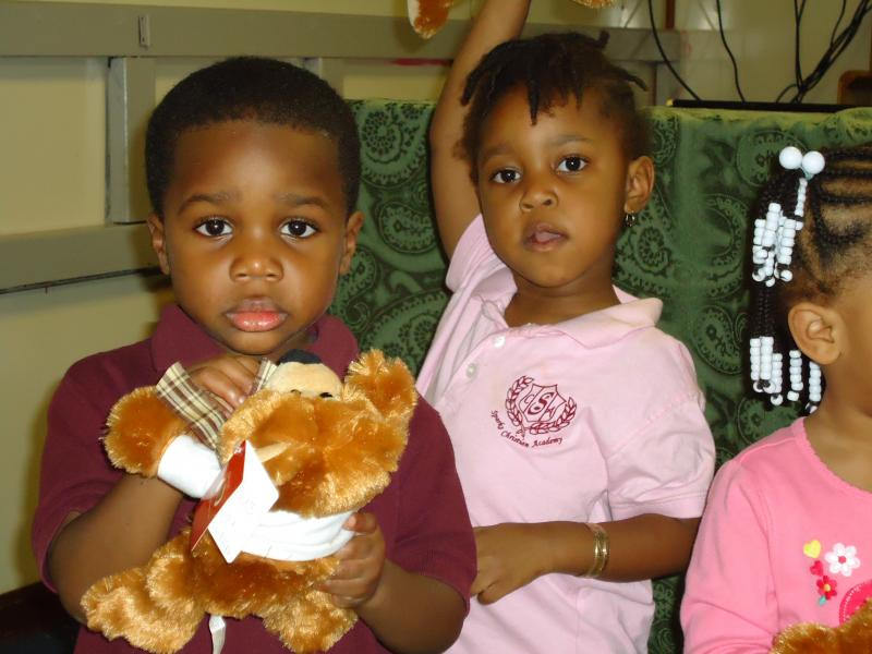 Children receiving JDC Teddy Bears at Sparks Academy 1-12-12